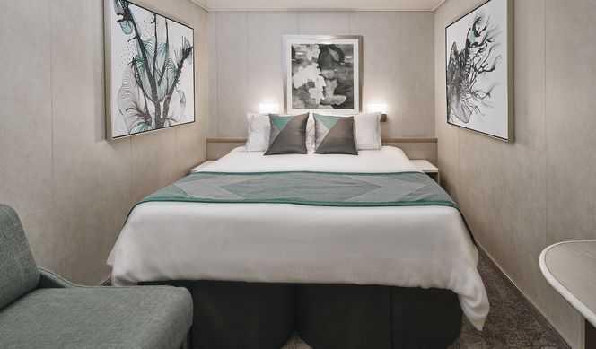 2 lits bas pouvant se convertir en 1 lit double, télévision, réfrigérateur, coin lecture, climatisation, sèche-cheveux. ( 13 m² )