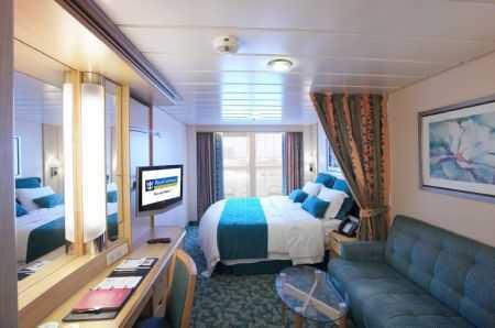 2 lits jumeaux convertibles en lit double and salle de bain privée. TV, climatisation. Environ 16 m² + balcon de 6 m².